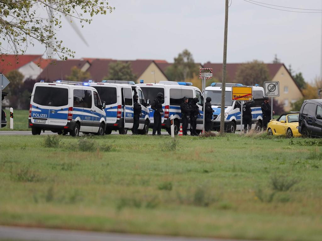 Policemen secure the area between Wiedersdorf and Landsberg where shots were fired. Picture: AFP