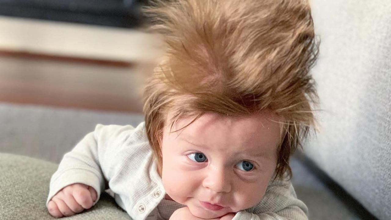 Baby Boston's 'insane' hair stuns strangers.