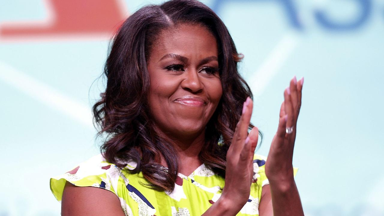 Michelle Obama waves after discussing her forthcoming memoir titled, Becoming, during the 2018 American Library Association Annual Conference. Picture: AFP