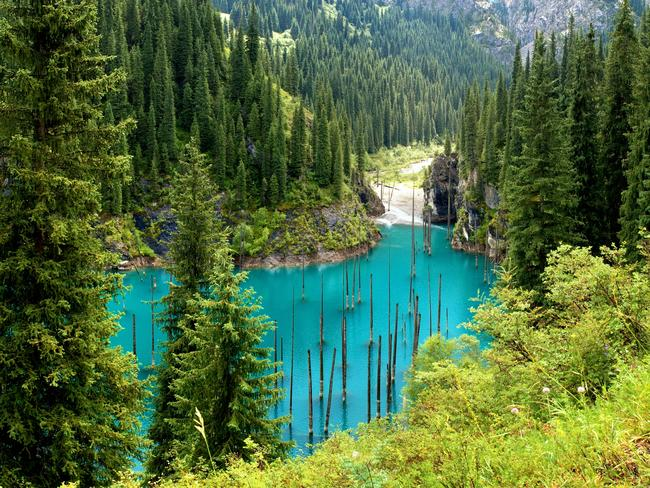 LAKE KAINDY, KAZAKHSTAN As the world's largest landlocked country, Kazakhstan makes up for itslack of coastline with inland waterfeatures, and foremost among them is Lake Kaindy. The otherworldly site, also known as the sunken forest, features brilliant turquoise water and ghostly, submerged spruce trees.