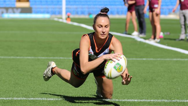 Paige Markey scoring for the Tigers in the touch football competition. Pic: Peter Tong