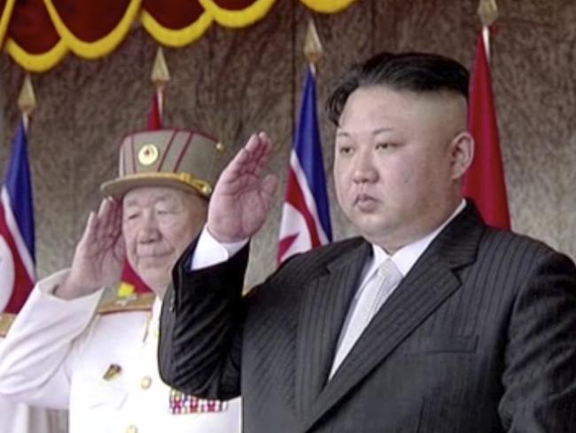 Kim Jong Un salutes during the parade.