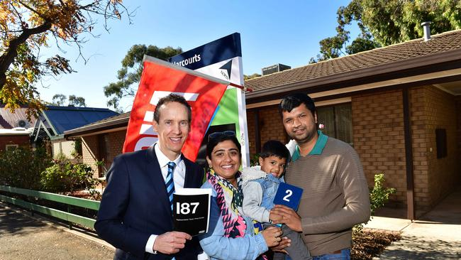 Auction Watch — Harcourts Brock Williams auctioneer Hamish Mill with the successful bidders for a three-bedroom home in St Peters. Buyers Teena Anish, and Anish Babu (pictured with their son Benjamin, 3) bought their home at auction yesterday for $586,000 and plan to renovate. PICTURE: KERYN STEVENS