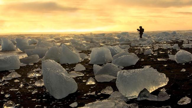2/14Diamond Beach, Iceland > The beach near Jökulsárlón sits close enough to the glacier of the same name to be studded with crystalline chunks of freshwater ice that shine all the more brightly against its black sand.
