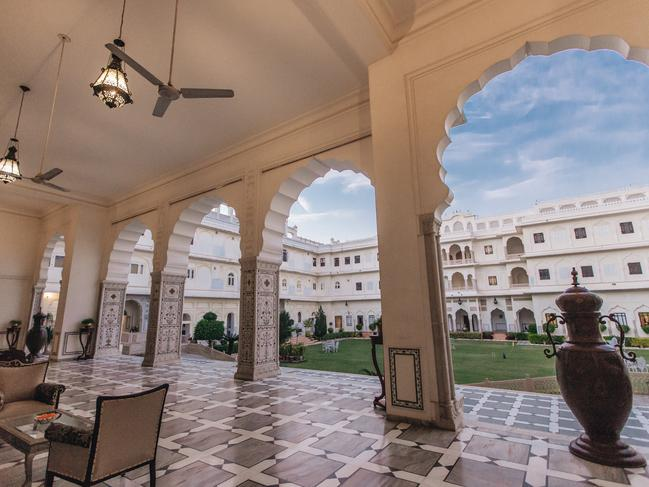 EXTRA LUXURY                   The grounds pillars, ornate archways, courtyards, palace pool, manicured lawns, sculptures and fountains make the history of The Raj Palace come alive. Inside decor brims with antiques and artifacts including oriental rugs, crystal chandeliers, and rich fabrics. Picture: Small Luxury Hotels