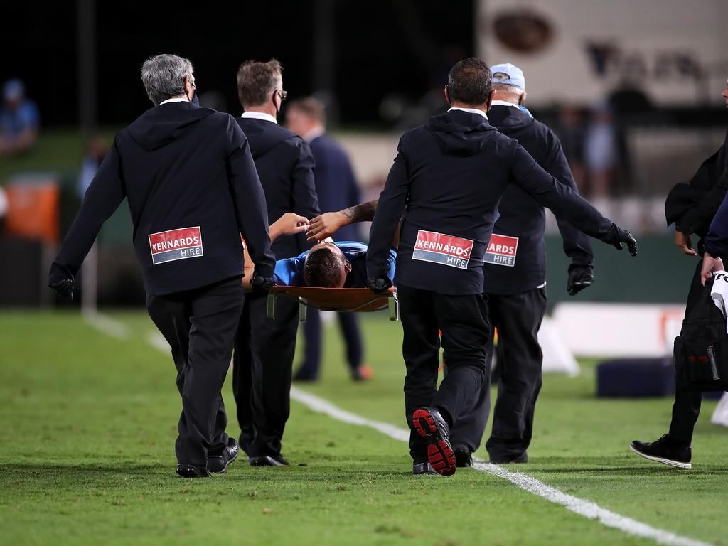 Chris Zuvela is stretchered off the field after hurting his knee in Sydney's defeat of Wellington. Picture: Mark Kolbe/Getty Images