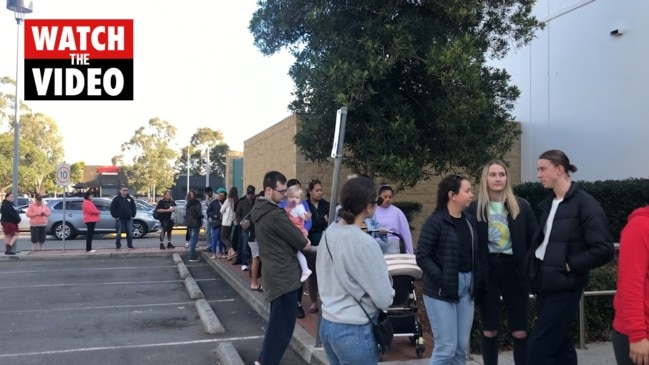 Queues of people line up for free doughnuts at Krispy Kremes in Penrith