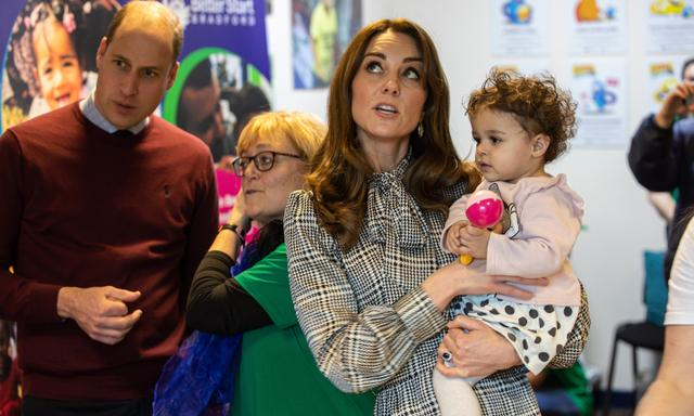 BRADFORD, ENGLAND - JANUARY 15: Prince William, Duke of Cambridge and Catherine, Duchess of Cambridge meet 18 Month old Sorayah Ahmad at the Khidmat Centre on January 15, 2020 in Bradford, United Kingdom. (Photo by Charlotte Graham - WPA Pool/Getty Images)