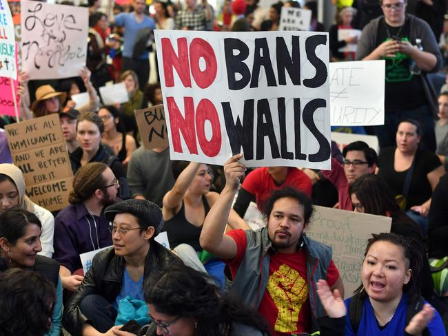 Protesters sit in the international terminal at San Francisco International Airport in San Francisco. Picture: AFP