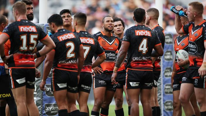 SYDNEY, AUSTRALIA - APRIL 25: Moses Mbye of the Tigers and teammates look dejected after a Sea Eagles try during the round seven NRL match between the Wests Tigers and the Manly Sea Eagles at Bankwest Stadium, on April 25, 2021, in Sydney, Australia. (Photo by Matt King/Getty Images)