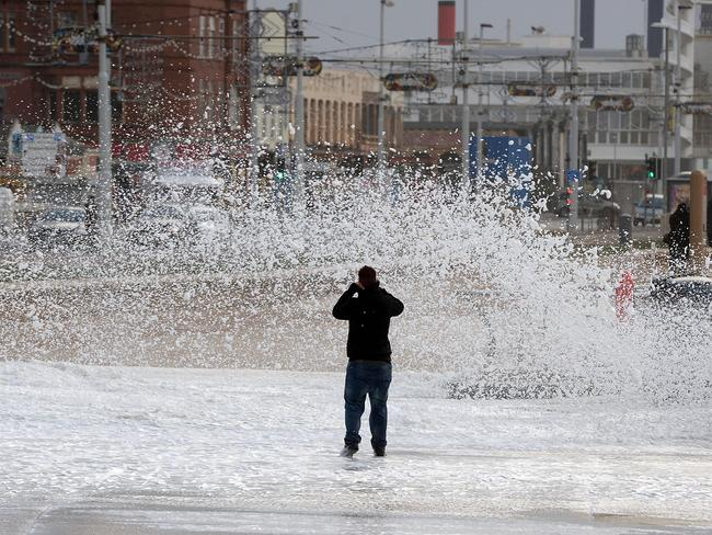 Brave snapper ... a man photographs big waves in Blackpool, England, on December 10. Picture: Getty Images