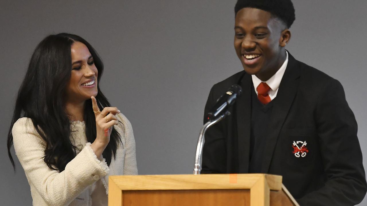 Meghan smiles as head boy Aker Okoye, speaks in a school assembly, during her surprise visit to the Robert Clack Upper School in Dagenham, Essex, in eastern London. Picture: Ben Stansall/Pool via AP