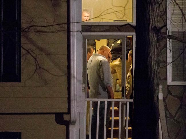 Police stand in the doorway of the Douglasville home. Picture: David Goldman / AP