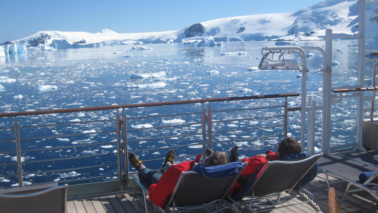 Passengers on deck chairs aboard Silverseas' expedition ship Silver Explorer in Antarctica.