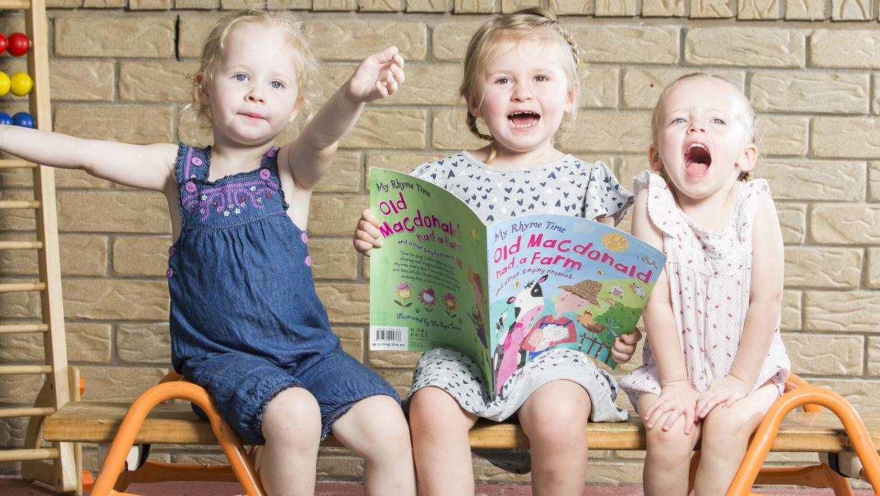 Alyse, Molly and Hayley read Old McDonald. Picture: Lachie Millard