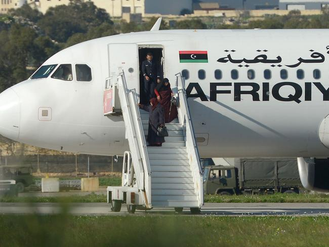 Passengers are released off of a hijacked Libyan plane. Picture: AFP/Matthew Mirabelli/ Malta OUT