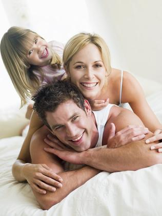 istock. Family in Bed