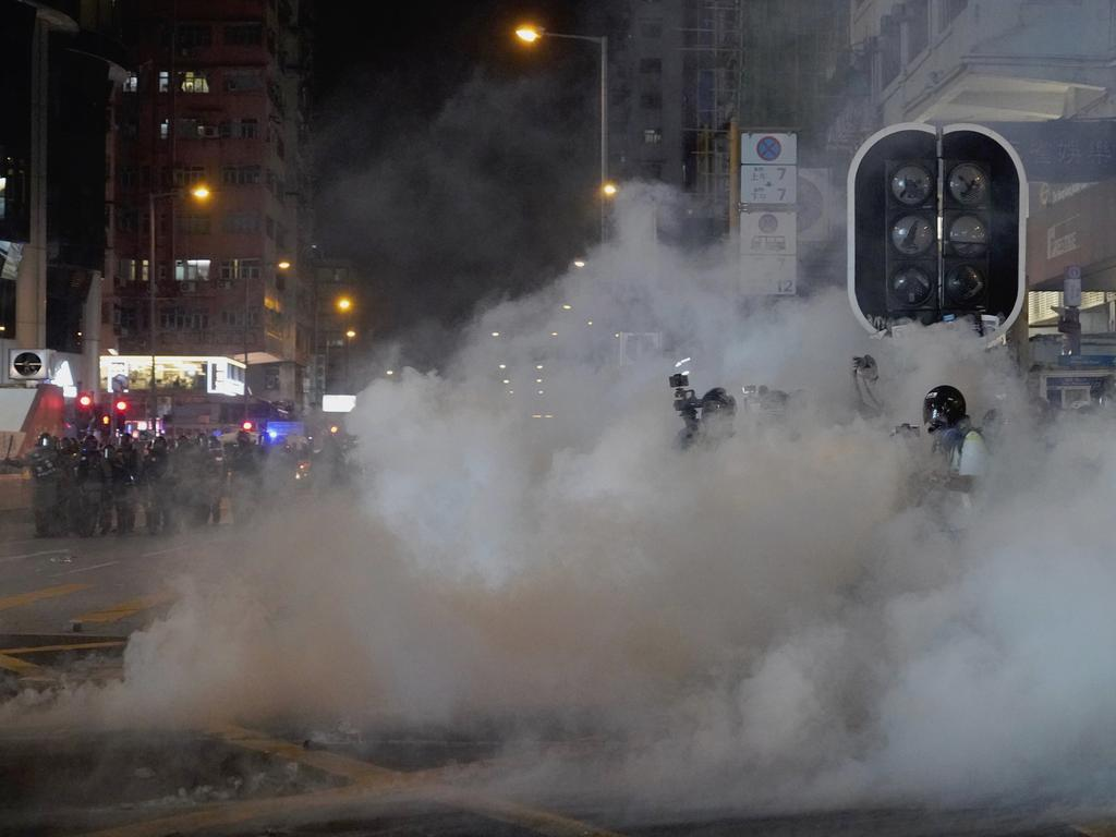 Tear gas engulfs protesters in Hong Kong. Picture: AP