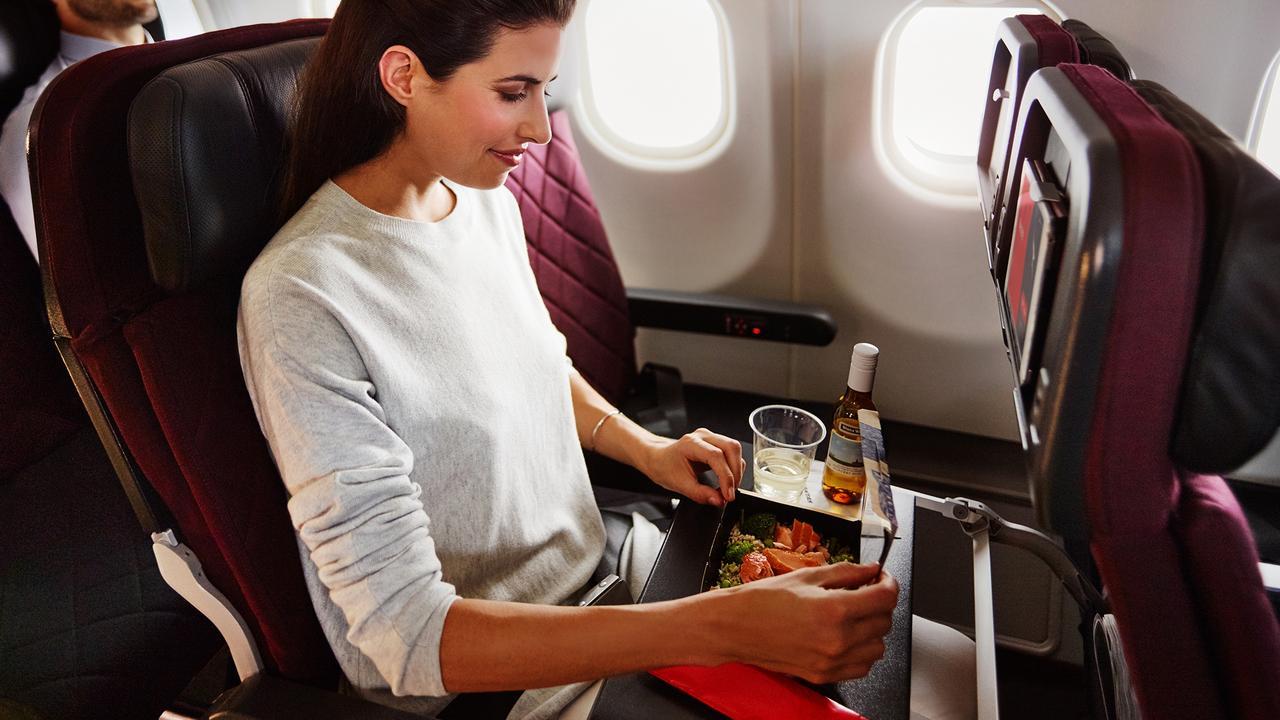 Dnata prepares the in-flight food for Qantas flights. Picture: Anson Smart, Brent Winstone