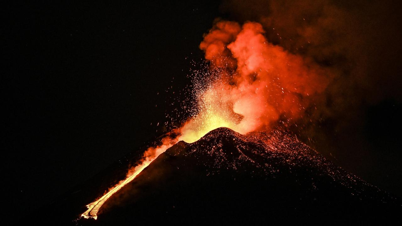 Mount Etna erupts in the night with lava fountains one kilometre high and a column of ash over 10km high heading towards nearby Tyrrhenian on February 23 in Catania, Italy. Picture: Getty Images