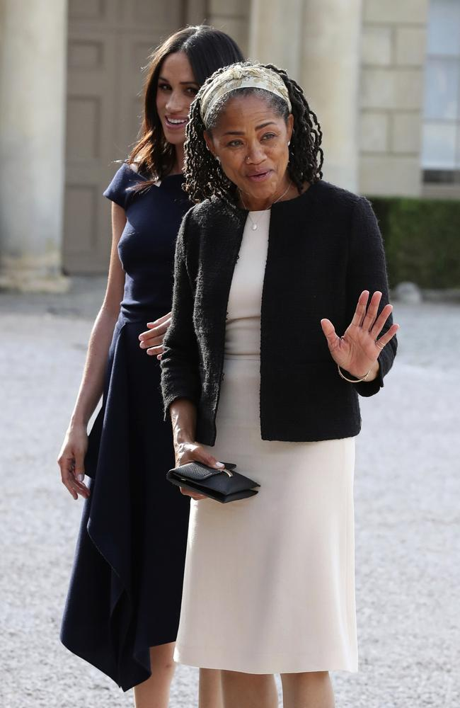 The yoga teacher and social worker practices her royal wave after enjoying afternoon tea with her daughter, Prince Harry, the Queen and the Duke of Edinburgh. Picture: Steve Parsons/Pool Photo via AP