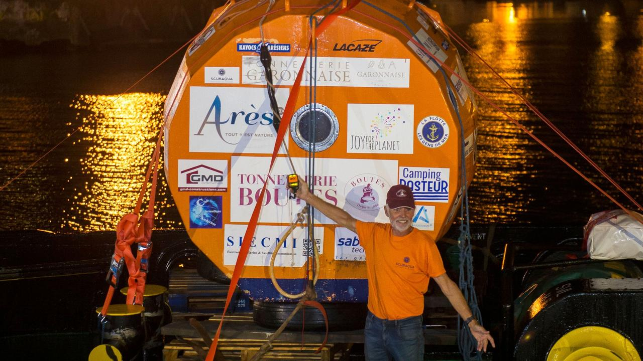 Jean-Jacques Savin and his ocean-crossing barrel on May 9 at Fort-de-France, Martinique after completing his journey. Picture: AFP