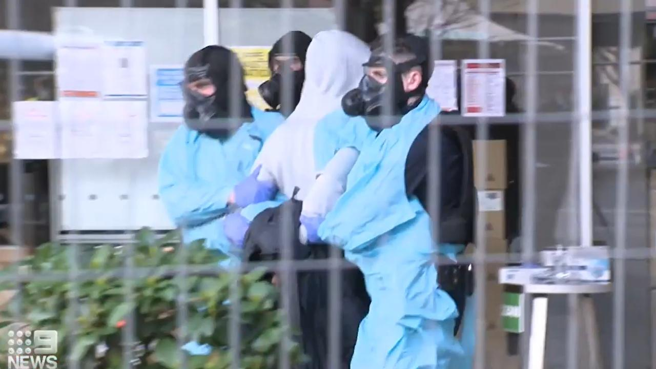 The men allegedly failed to stay in their rooms and wear masks.