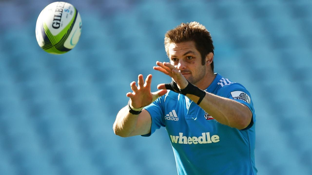 SYDNEY, AUSTRALIA - AUGUST 01: Richie McCaw of the Crusaders handles the ball during the Crusaders Super Rugby Grand Final Captain's Run at ANZ Stadium on August 1, 2014 in Sydney, Australia. (Photo by Matt King/Getty Images)