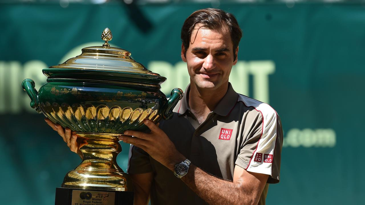 Roger Federer from Switzerland poses with the Halle trophy.