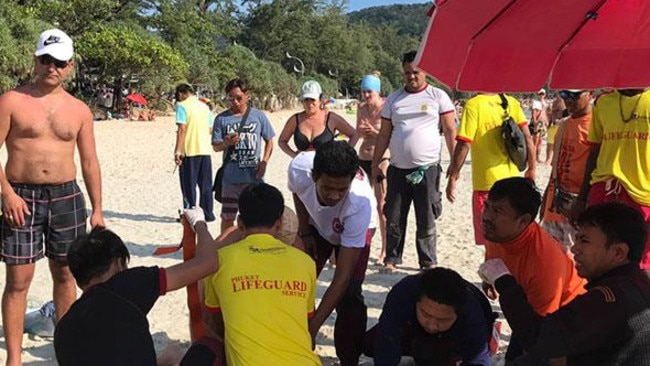 Lifeguards and rescue workers give an Australian tourist first aid after a jet-ski crash off Kata beach in Phuket on Sunday. Photo via Third Navy Region / The Bankok Post