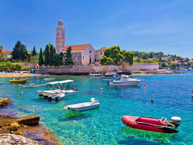 """HVAR, CROATIA: Croatia has been having a """"moment"""" that's lasted a good five-plus years. Now reigning as one of the fastest growing European holiday spots for Brits, and by proxy Aussies when on their European sojourns, this surge of astronomical proportions has seen the country's most popular city, Dubrovnik, swamped with sightseers. Reports of unregulated cruises causing chaos and Game of Thrones fans causing bottleneck queues around the filming locations from the hit TV show, abound. Though Dubrovnik may currently be a victim of its own success, you can still get a fix of Croatia as it was by heading to Hvar. Hailed as the sunniest port in the country, the small island has seen P&O, Azamara, Cunard, Silversea, Ponant and Peregrine Adventures all drop anchor to allow passengers to take advantage of its beautiful beaches, ancient hamlets and beautiful landscapes."""