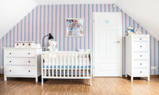 Little baby's room with white furnitures: bed, cabinets, door; red and blue striped wallpaper, Teddy Bears. Picture on the wall you may buy separately #44839208.