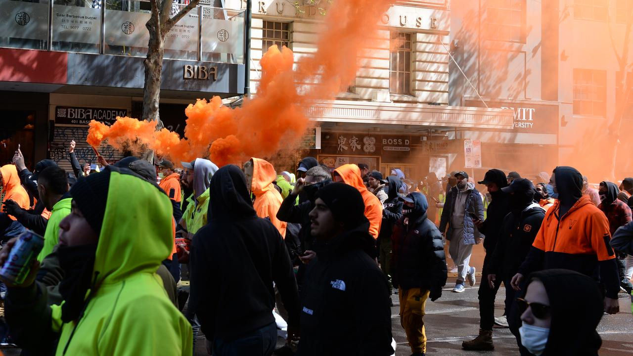 Protesters walk through central Melbourne. Picture: Andrew Henshaw