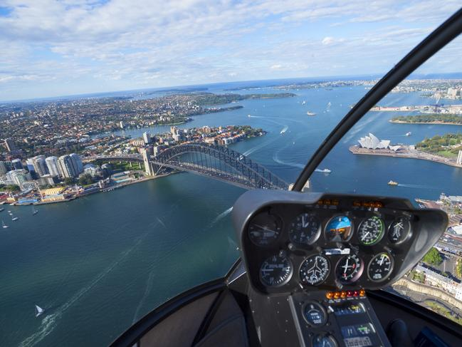 SYDNEY, AUSTRALIA Let's start close to home, shall we? While we might be biased, when it comes to fascinating cities to see from above, Sydney is hands-down one of the greatest. Long stretches of beaches, a harbour dotted with boats and islands, and, of course, those little ol' landmarks, the Opera House and the Bridge — all of it make a sweeping view over the city pretty damn superb. And, for even more of a good time, board an after-hours flight to see the CBD grid all lit up at night.
