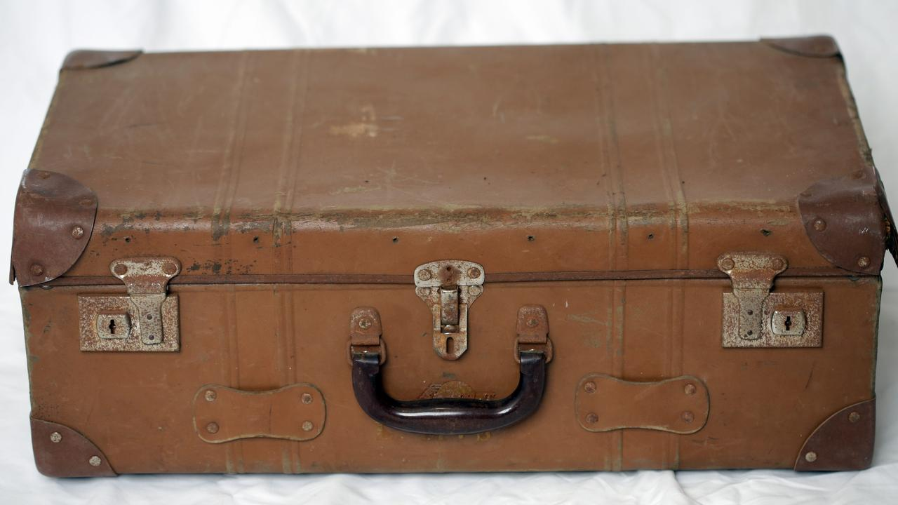 If this suitcase could talk it would have stories to tell.