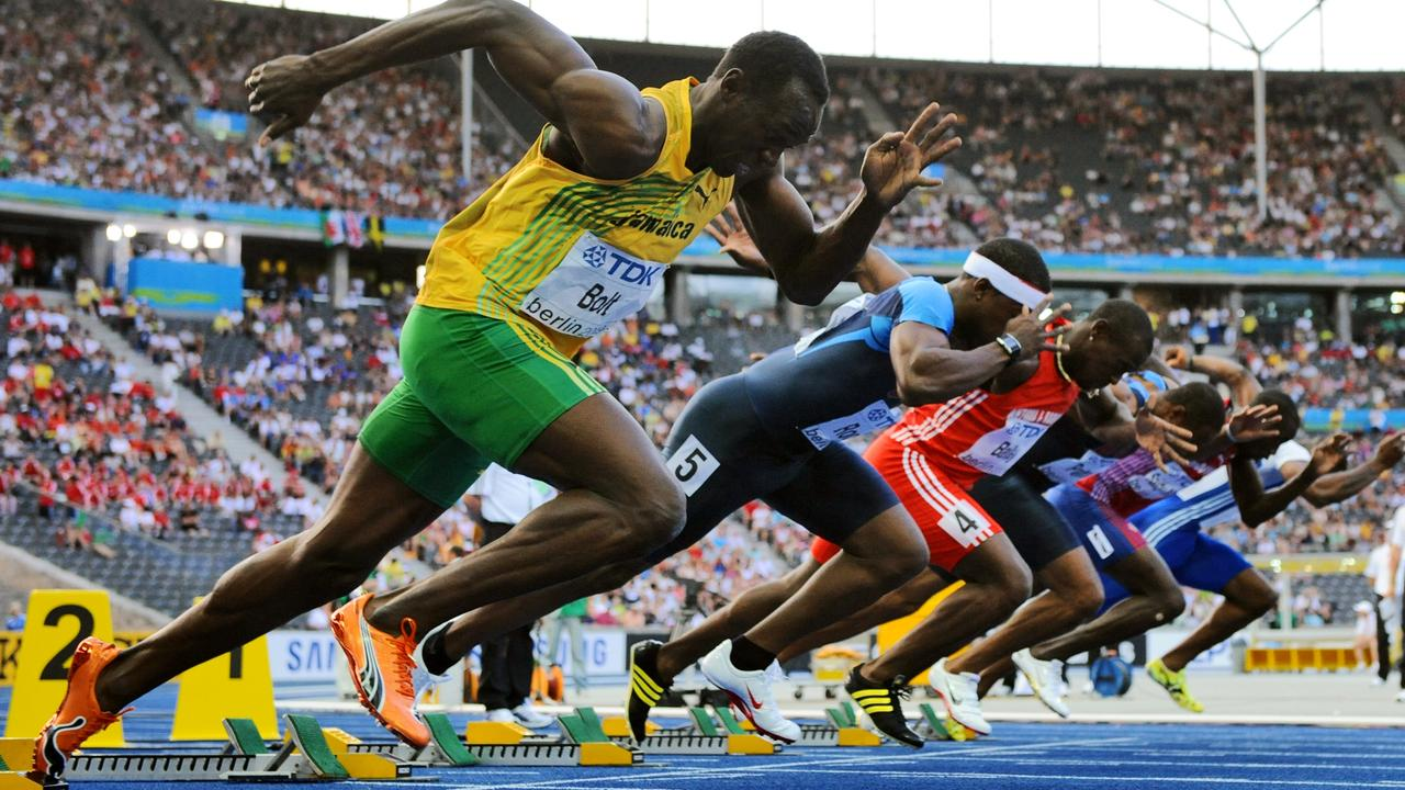 Jamaica's Usain Bolt (L) competes in the