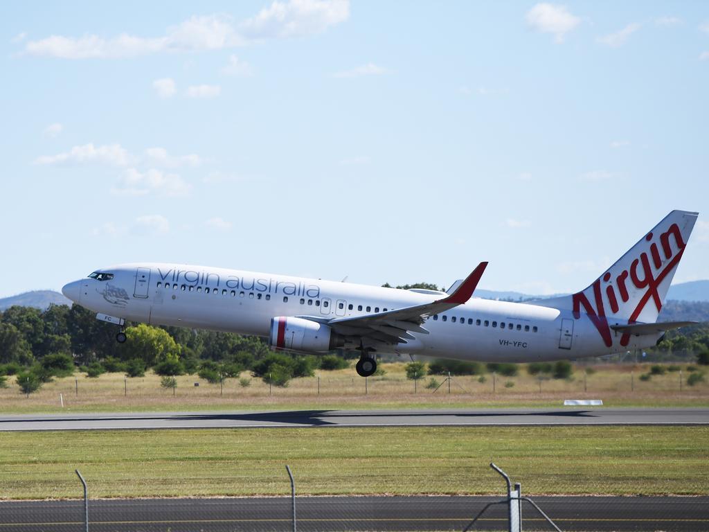 An almost empty Virgin flight departs Rockhampton for Brisbane.