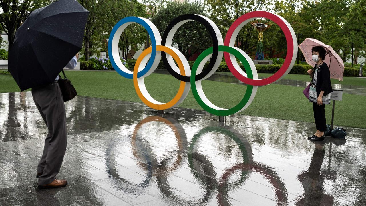 Olympic rings reflected in the rain near the National Stadium, main venue for the Tokyo 2020 Olympic and Paralympic Games, in Tokyo on June 23, 2021. Picture: AFP