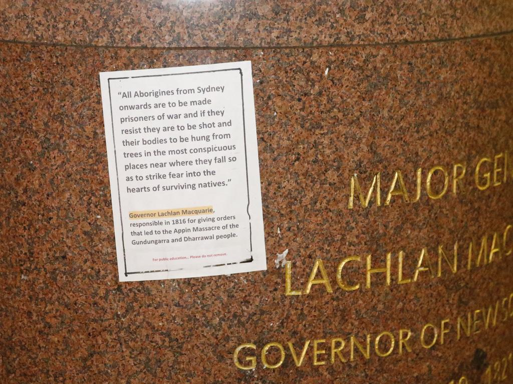 A sheet of paper claiming historical wrongdoings against aboriginals by Lachlan Macquarie is glued to the statue with a line asking for it to not be removed for public education Picture : Steve Tyson Location : Sydney, Cnr St James road x Macquarie street
