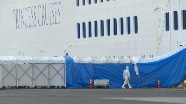 Ambulances wait outside quarantined cruise ship