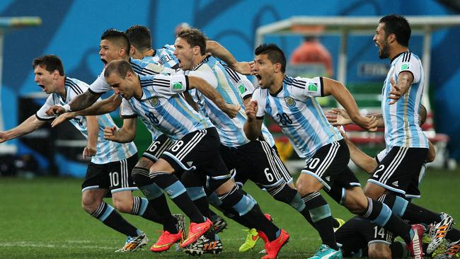Argentina celebrate their penalty success over the Dutch.