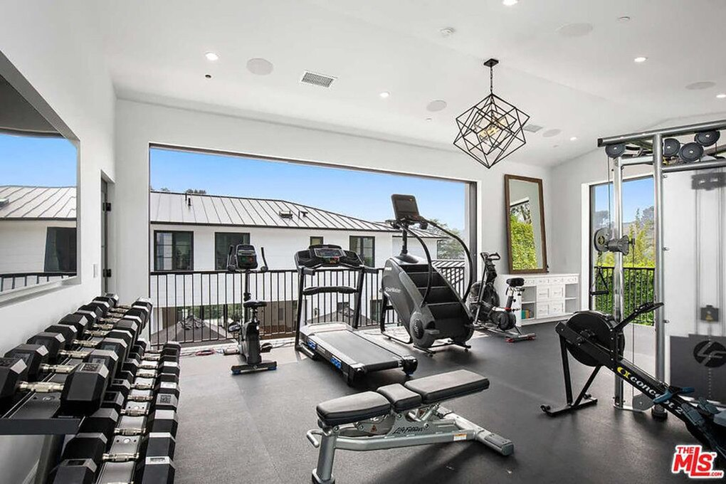 The guesthouse has a huge home gym. Picture: Realtor