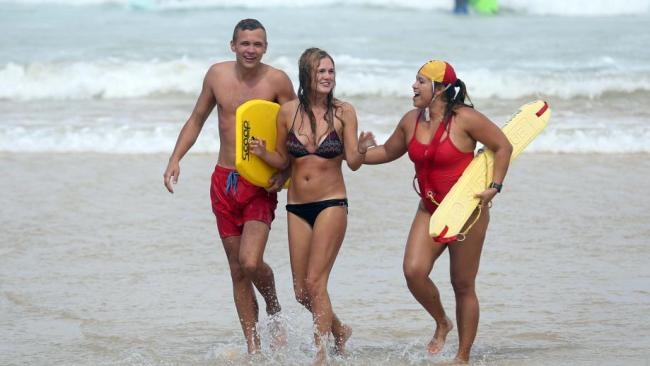 Lifesavers direct people from the water after the decision was made to close Bondi Beach on Saturday. Picture: Matrix