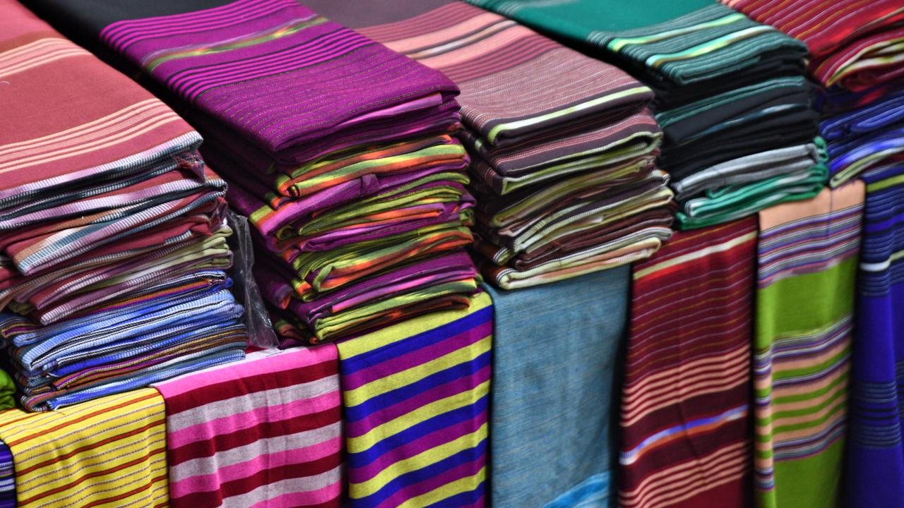 Textiles for sale at the Dao Wow market. Picture: Ronan O'Connell