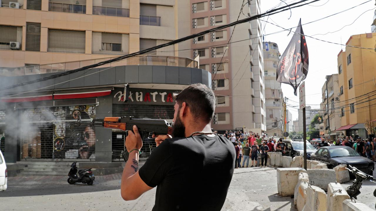 A Shiite fighter takes aim during clashes in the area of Tayouneh, in the southern suburb of the capital Beirut.