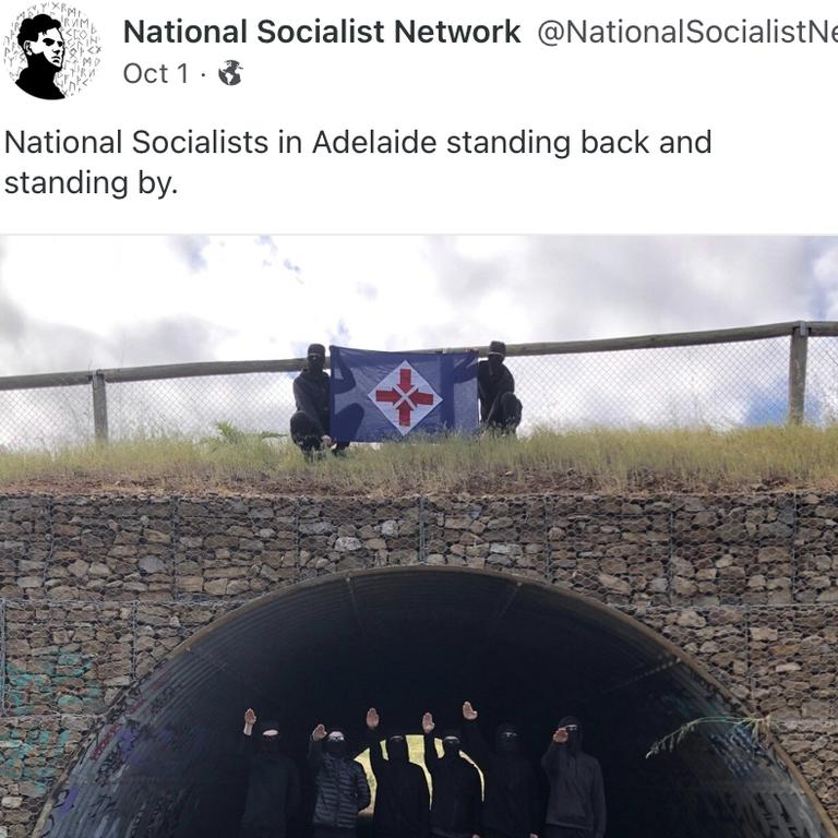 Neo-Nazi group the National Socialist Network's Adelaide members gather to perform the Hitler salute.