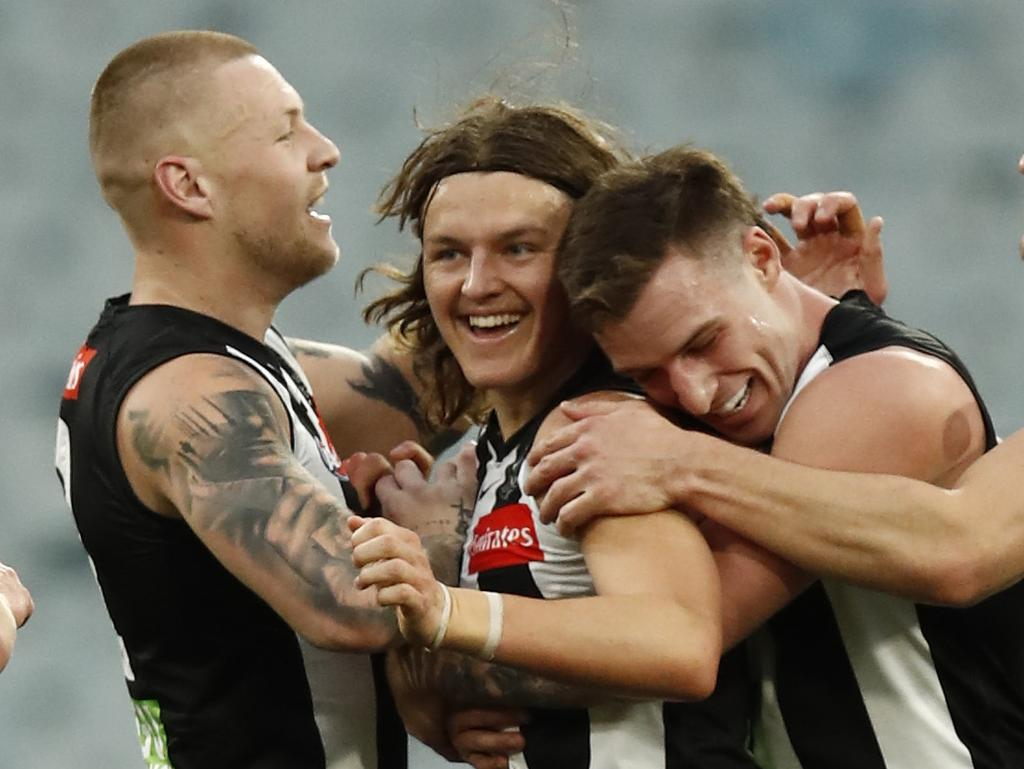 MELBOURNE, AUSTRALIA - JULY 31: Jack Ginnivan of the Magpies celebrates a goal during the round 20 AFL match between Collingwood Magpies and West Coast Eagles at Melbourne Cricket Ground on July 31, 2021 in Melbourne, Australia. (Photo by Darrian Traynor/Getty Images)