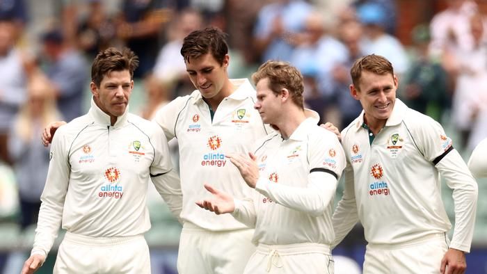 ADELAIDE, AUSTRALIA - DECEMBER 17: Tim Paine of Australia, Pat Cummins of Australia, Steve Smith of Australia and Marnus Labuschagne of Australia after the signing of the national anthem during day one of the First Test match between Australia and India at Adelaide Oval on December 17, 2020 in Adelaide, Australia. (Photo by Cameron Spencer/Getty Images)