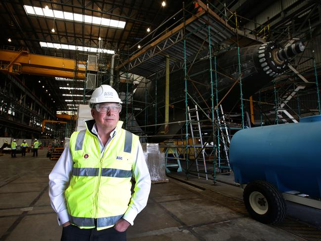Shake up ... Steve Ludlam, former chief executive of the Australian Submarine Corp in front of the tail of a Collins Class submarine at Techport in Adelaide.