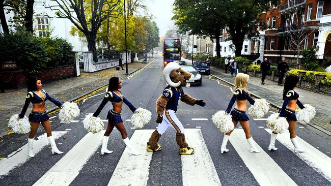 St. Louis Rams cheerleaders and their mascot Rampage pose for photographs on the Abbey Road zebra crossing in London in 2012.